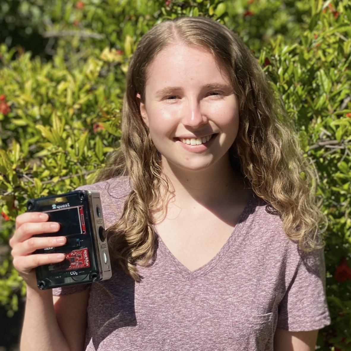 Erica holding the Quest CO2 sensor module